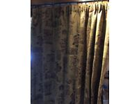 Two Pairs of thick fully lined curtains.
