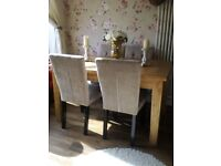 Beautiful solid oak dining table and four chairs in immaculate condition
