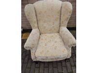 A LOVELY QUEEN ANN WING BACK CHAIR IN A TRADITIONAL FLORAL FABRIC