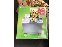 Unwanted gift. Canon Selphy photo printer. Boxed, never unwrapped. All complete.