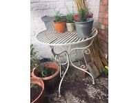 White metal garden table