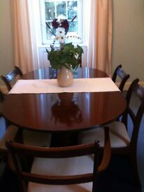 Rosewood Dining table & 6 covered chairs