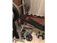 "York weights bench, 1"" bar and various weights. Good condition. Pick up only"