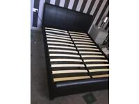 Black leather look sleigh bed king size