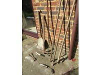 Old garden hand tools plus possible World War hoe and wire cutters