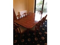 Yew Dining Table with 10 chairs. Two supporting pedestals with 2 removable sections.