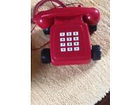Red landline phone. Remember Direct line Ad.
