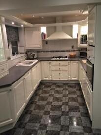 Kitchen units, kitchen cabinets, fridge/freezer, oven and hob, and sink