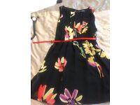 Black flowered knee length dress size 12 worn once has red belt