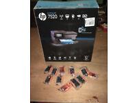 hp Photosmart 7520 wireless printer/scanner/copier, complete with 10 spare ink cartidges.