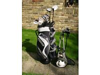 Great set of matching golf clubs Plus golf cart
