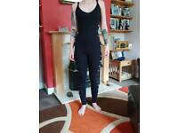 Black all in one with slit sides, Size 8