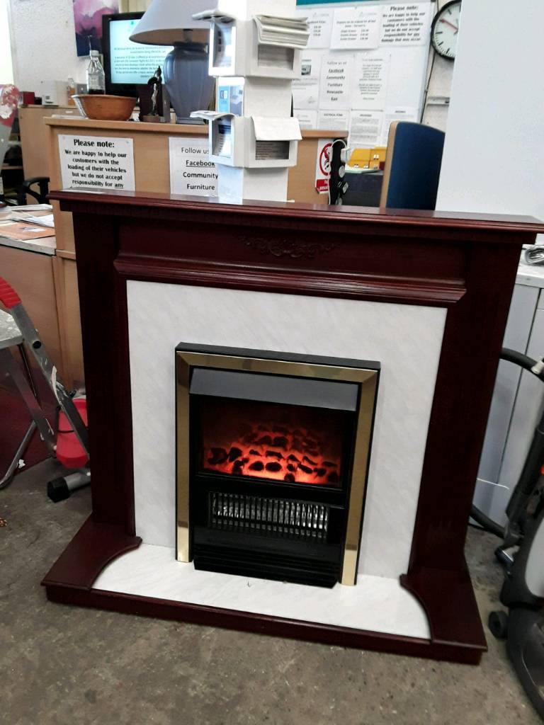 Modern Fire and Red Wood Surround. Delivery Available