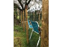 Chain link fence with wooden posts