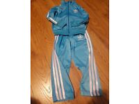 Kids blue adidas tracksuit brand new for 5 years....