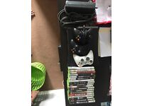 Delivery included-120GB Xbox 360 with 3 controllers with 18 games