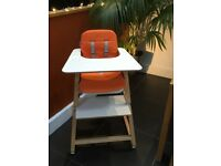 Knuma 4 in 1 Connect White and Beech Highchair, with Orange cushion. Immaculate, rarely used.