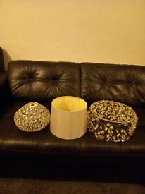 A grey lampshade and 2 glass crystal shade