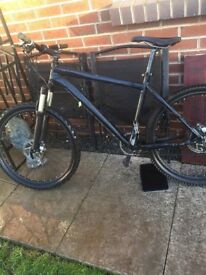 Black mountain bike with snap back brakes