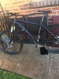 Black mountain bike with snap back brakes