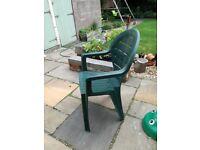 Four green plastic garden chairs