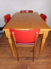 Dining table and 4 chairs with red seat and back
