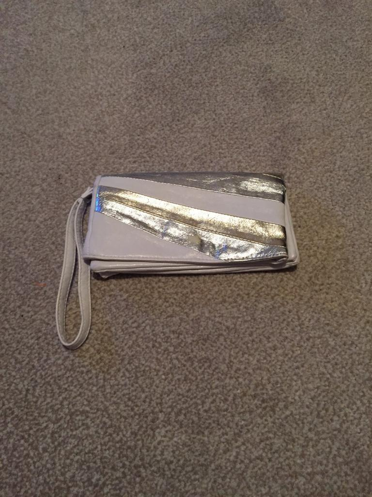 White bag with silver and gold detail