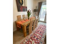 Solid Oak Table with antique cracked oak legs and 6 BRAND NEW chairs