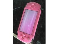 Pink PSP games console with game