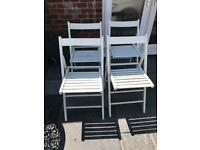 Set of four white wooden folding garden patio chairs