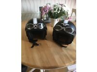 Two retro black helmets with goggles excellent condition