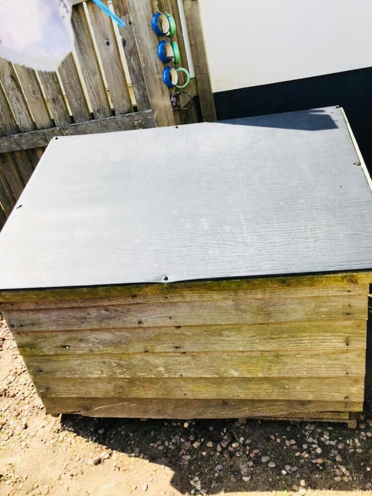Wooden garden storage box with lid