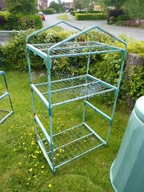 Metal/plastic shelves suitable for a shed or greenhouse.