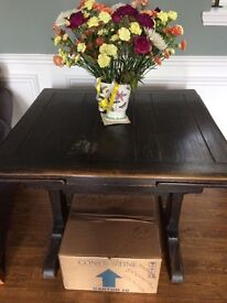 Dark brown solid wood extendable dining table