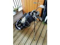 Random collection of golf clubs and bag