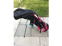Ladies golf bag with clubs and golf balls