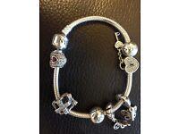 Pandora bracelet with 4 charms