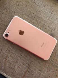 Rose Gold iPhone 7, 128GB for sale (less than 1 year old)