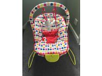 Tippitoes baby bouncer with rattle toys