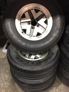 4 Goodyear winter tires with mags:235/75R15