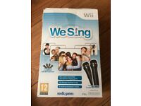 Wii We Sing Karaoke game with microphones, used but in excellent condition.