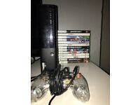 XBOX360 E W/ 13 Games inc GTA V