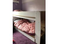 Bunk beds with mattresses and storage