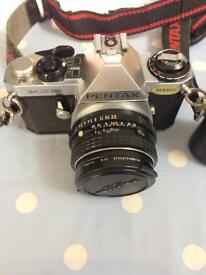 Pentax me super slr camera with 3 lenses and other bits