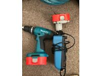 Makita 8891d drill includes 2 battery's and 1 charger