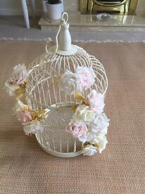 Cream ornamental birdcage with flowers attached (for wedding day)