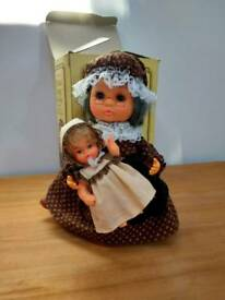 Musical revolving granny with baby
