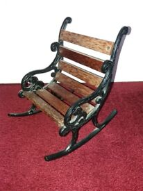 Cast iron and wooden slatted miniature rocking chair