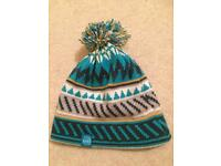 New knitted bobble hat