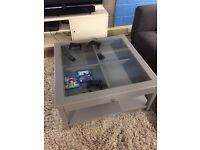 Coffee table with glass top & large drawer